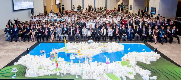 "Mrs Carrie Lam, Chief Executive of the HKSAR, and Mr Willy Lin, Chairman of HKPC, with participants of the ""Hong Kong Secondary Schools 3D Printing Design Competition"" are all smiles with Guinness World Record setting 3D-printed Victoria Harbour model"