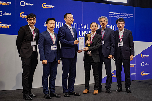 """Mr Terrie Hung, Chief Highway Engineer (Research and Development) of Highways of the HKSAR Government (3rd from right) and Dr Lawrence Cheung, Chief Innovation Officer of HKPC (1st from right) and team received The Honorable Mention Prize of the Chinese Delegation for Invention and Innovation and The Gold Medal with Congratulations of Jury for """"RoadBot 1""""."""