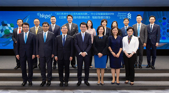 """Mr Edward Yau, Secretary for Commerce and Economic Development of the HKSAR Government (front row, centre); Mr Willy Lin, Chairman of HKPC (front row, third from left); Ms Mary Huen, Hong Kong, CEO of Standard Chartered Hong Kong (front row, third from right); Mr Mohamed Butt, Executive Director of HKPC (front row, second from left); Dr Lawrence Cheung, Chief Innovation Director of HKPC(front row, first from left); Ms Vicky Kong, Managing Director, Head, Retail Banking, Hong Kong, Standard Chartered Bank (Hong Kong) Limited (front row, second from right) and Ms Winnie Tung, Managing Director, Head, Business Banking, Retail Banking, Hong Kong, Standard Chartered Bank (Hong Kong) Limited (front row, first from right) officiated the opening of """"Enterprise 4.0: Heading Towards Digital Economy to Drive Business Development"""" SME Conference, and posed for a group photo with various business and industry leaders, representatives from SMEs, economists and academia."""