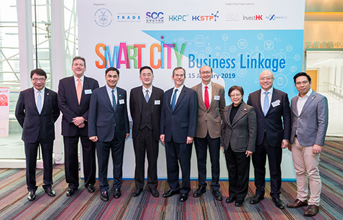 "Dr Bernard Chan, Under Secretary for Commerce and Economic Development of the HKSAR Government (fourth from left); Mr Thomas Hodges, Acting U.S. Consul General to Hong Kong and Macau (fifth from left); Dr Winnie Tang, Founder and Honorary President of SCC (third from right); Mr Mohamed D. Butt, Executive Director of HKPC (third from left); and Ir Peter Yeung, Head of Electronics & ICT Clusters, Smart City Platform of HKSTP (fourth from right); Mr Charles Ng, Associate Director-General of Investment Promotion of InvestHK (second from right) pose for a photo at the ""Smart City Symposium - Business Linkage"""