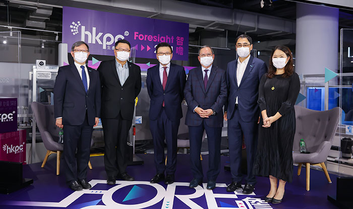 """Professor K C Chan, Chairman of WeLab Bank and Senior Advisor of WeLab (third from left); Dr Peter K N Lam, Chairman of Hong Kong Trade Development Council (third from right); Dr Sunny Chai, Chairman of Hong Kong Science and Technology Parks Corporation (second from left); Mr Willy Lin, Chairman of HKPC (first from left); Mr Mohamed Butt, Executive Director of HKPC (second from right); and Moderator, Dr Kaman Lee, Head, Department of Journalism and Communication, Associate Professor of Practice, Hong Kong Shue Yan University (first from right), pose for a photo at the opening forum of """"Foresight 2021""""."""