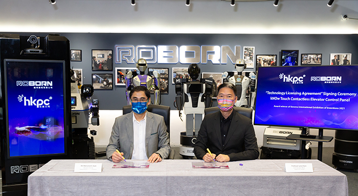 """Mr Mohamed Butt, Executive Director of HKPC (left) and Professor Larry Poon, Co-founder and Chief Executive Officer of Roborn DT Limited, sign the technology licensing agreement to promote the wider application of """"kNOw Touch – Contactless Elevator Control Panel"""" solution"""