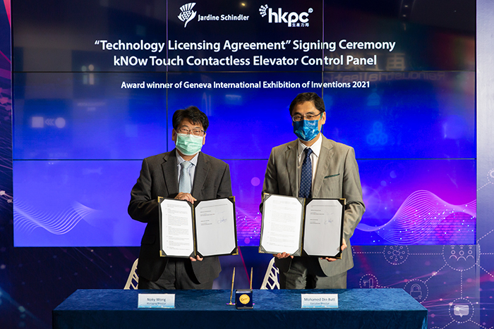 """Mr Mohamed Butt, Executive Director of HKPC (right) and Mr Noky Wong, Managing Director of Schindler Lifts (Hong Kong) Limited, sign the technology licensing agreement to promote the wider application of """"kNOw Touch - Contactless Elevator Control Panel"""" solution"""